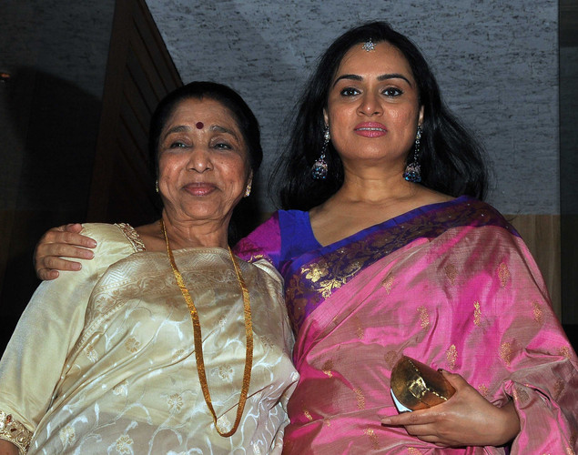 Asha Bhosle (L) and actress Padmini Kolhapuri pose during the birthday celebration of Poonam Dhillon in Mumbai on April 18, 2012.