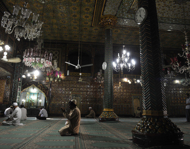 Kashmiri Muslims pray at the Shah-i-Hamdaan shrine during Ramadan in Srinagar.