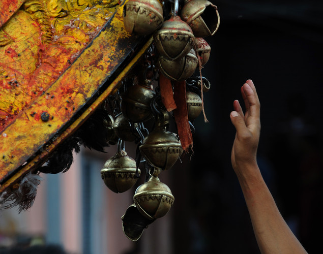 A Nepalese reveller rings bells on a wooden chariot during celebrations for the Nepalese New Year or 'Bisket Jatra' in Bhaktapur.
