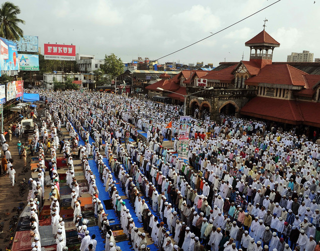 Indian Muslims offer Eid al-Fitr prayers on a street outside the railway station in Mumbai.