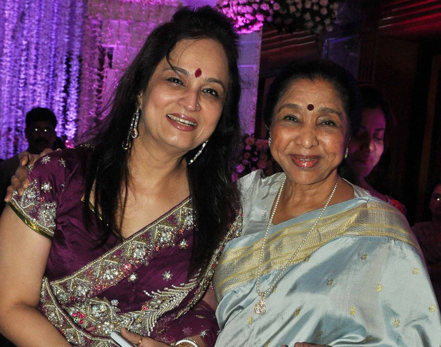 Bollywood playback singer Asha Bhosle (R) with producer Smita Thackeray attend the wedding reception of playback singer Sunidhi Chauhan and musician Hitesh Sonik.
