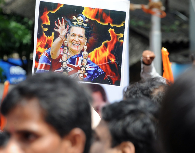 A portrait mocking Indian Congress Party President Sonia Gandhi is seen during a protest by Indian Shiv Sena party activists against a fuel price hike in Mumbai.