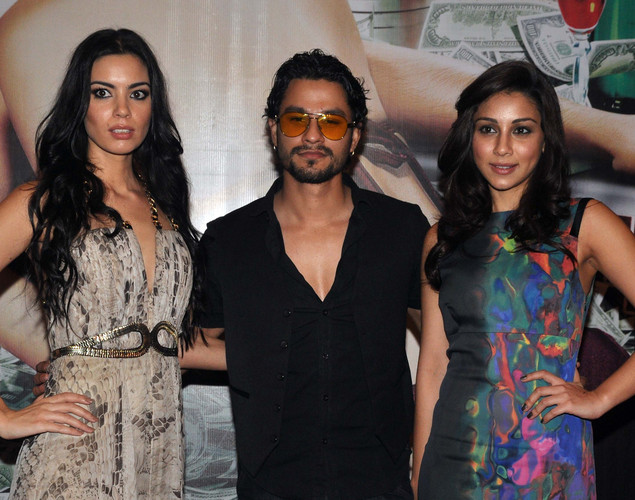 Kunal Khemu,(C), Mia Uyeda, (R) and Amrita Puri attend the success party for the cast of Hindi film 'Blood Money' in Mumbai.