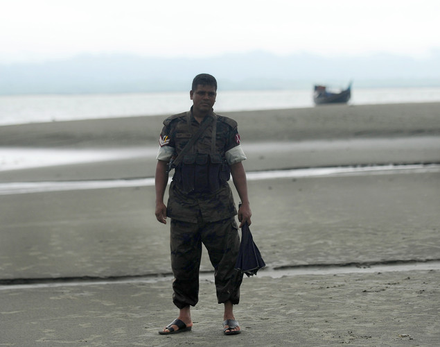 Bangladeshi Border Guard (BGB) personnel patrol beside the Naf river in Taknaf .