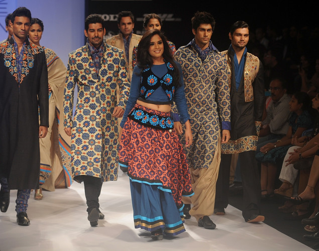 Models showcase creations by designer Debarun on the third day of Lakme Fashion Week (LFW) winter/festive 2012 in Mumbai on August 5, 2012.