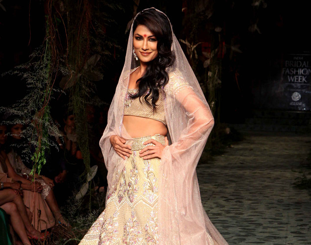 Indian Bollywood actress Chitrangada Singh showcases a creation by Indian designer Tarun Tahiliani on the opening day of Aamby Valley India Bridal Fashion Week 2012 in Mumbai.