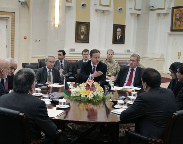 Britain's Prime Minister David Cameron (C), talks with Pakistani Prime Minister Raja Pervaiz Ashraf (R), and Afghan President Hamid Karzai (L) during a meeting at the presidential palace in Kabul.