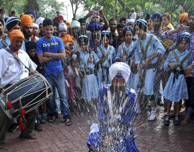 Sikh devotees display martial art skills during the religious procession in Amritsar.