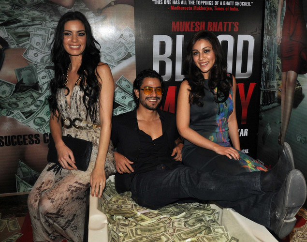 Kunal Khemu,(C), Mia Uyeda,(R) and Amrita Puri attend the success party for the cast of Hindi film 'Blood Money' in Mumbai.