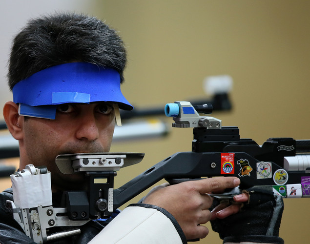 India's Abihinav Bindra competes in the 10m Air Rifle men qualifying round at the Royal Artillery Barracks in London on July 29, 2012 during the London 2012 Olympic Games.