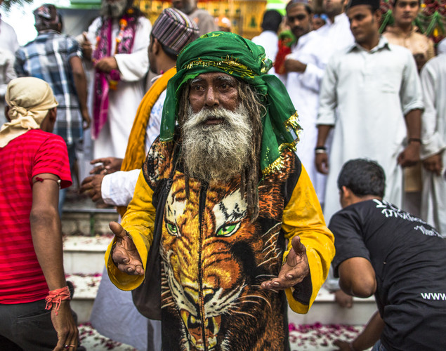 A Sufi Muslim pilgrim gestures after paying respects at the 'durgah' or shrine, where Muhammad Moin-ud-din Chisti is buried, during the annual 'Urs' procession.