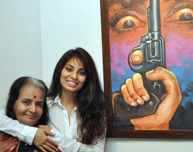 Manisha Kelkar (R) poses with her mother during a Painting Exhibition of promoting her upcoming film Bandook in Mumbai.