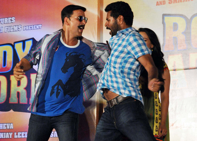 Akshay Kumar (L) plays during the launch of the trailer of forthcoming Hindi film 'Rowdy Rathore'