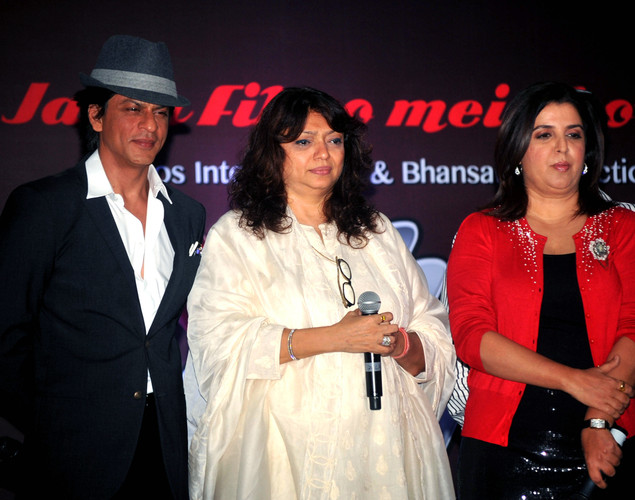 Bollywood film actors Shahrukh Khan (L) and Farah Khan (R) pose during the third teaser poster and music launch of the forthcoming Hindi film 'Shirin Farhad Ki Toh Nikal Padi' directed by Bela Bhansali Sehgal (C) in Mumbai.