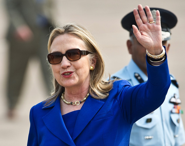 US Secretary of State Hillary Clinton waves on her arrival at Palam Air Force Station in New Delhi.