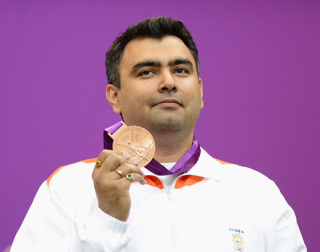 Bronze medallist Gagan Narang of India poses with the bronze medal won in the Men's 10m Air Rifle Shooting final final on Day 3 of the London 2012 Olympic Games at The Royal Artillery Barracks on July 30, 2012 in London, England.