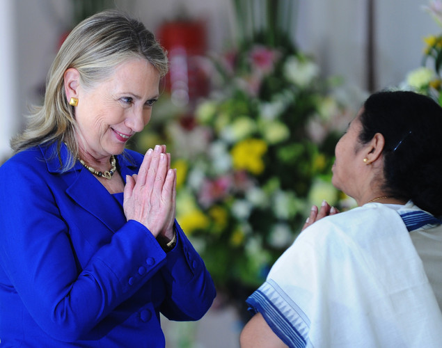 US Secretary of State Hillary Clinton (L) returns a traditional gesture from India's West Bengal state Chief Minister Mamata Banerjee at the Writers' Building, which houses the state secretariat, in Kolkata.