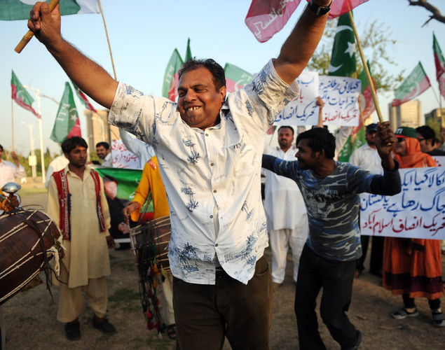 Supporters of Pakistani cricketer turned politician Imran Khan of Pakistan Tehreek-i-Insaaf (PTI - Movement for Justice) dance in celebration following the verdict against Pakistani Prime Minister Yousuf Raza Gilani in Islamabad.