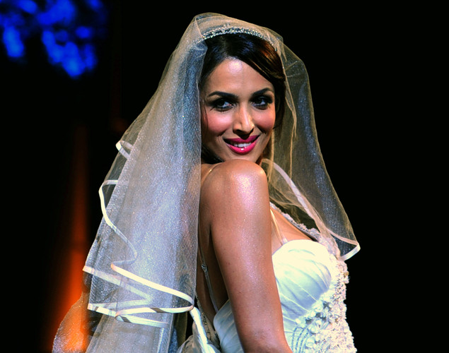 Bollywood actress Malaika Arora Khan showcases a creation by Indian designer Mandira Wirk during the Aamby Valley India Bridal Fashion Week in Mumbai.