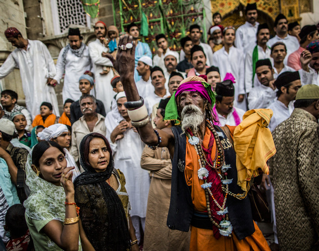 A Sufi Muslim devotee gestures to other pilgrims to enter the 'durgah' or shrine, where Muhammad Moin-ud-din Chisti is buried, during the annual 'Urs' procession.