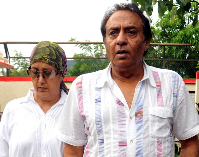 Bollywood actor Ranjeet, accopanied by his wife, attends the cremation ceremony of late Indian actor Dara Singh in Mumbai.