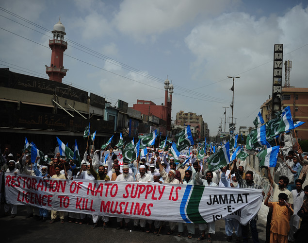 Activists of Jamaat e Islami Pakistan march during a rally in Karachi to denounce the resumption of NATO supplies into Afghanistan.
