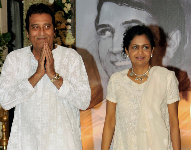 Indian Bollywood actor Vinod Khanna with wife attend a prayer function in memory of late actor Rajesh Khanna in Mumbai.