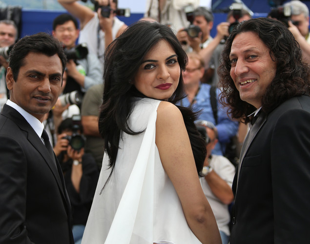 Nawazuddin Siddiqui (L), Niharika Singh and Anil George pose during the photocall of 'Miss Lovely' presented in the Un Certain Regard selection at the 65th Cannes film festival.