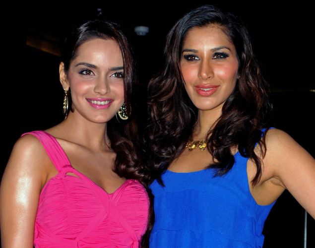 Bollywood personalities Shazahn Padamsee (L) and Sophie Choudhry (R) attend the DJ Mag launch event in Mumbai.