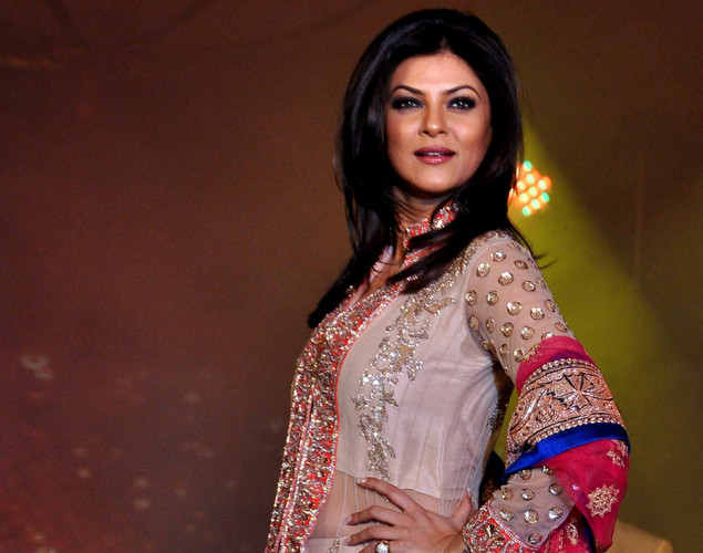 Sushmita Sen displays a creation by designer Manish Malhotra for a public awareness campaign Save and Empower the Girl Child in Mumbai.