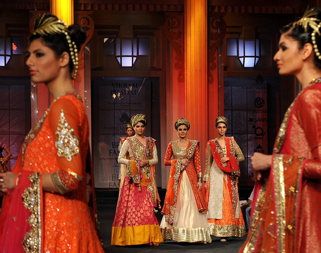 Indian models showcase creations by Indian designer Vikram Phadnis on day five of the Aamby Valley India Bridal Fashion Week 2012 in Mumbai.