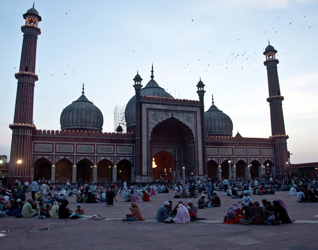 Indian Muslim families break their fast during sunset on the first day of the fasting month of Ramadan at the Jama Masjid Mosque in New Delhi.