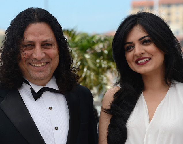 Anil George and Niharika Singh pose during the photocall of 'Miss Lovely' presented in the Un Certain Regard selection at the 65th Cannes film festival.