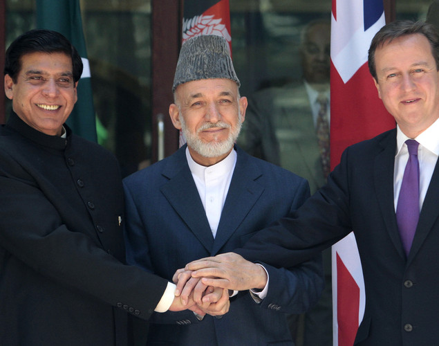 Britain's Prime Minister David Cameron (R), Pakistani Prime Minister Raja Pervez Ashfraf (L), and Afghan President Hamid Karzai shake hands before a meeting at the presidential palace in Kabul.