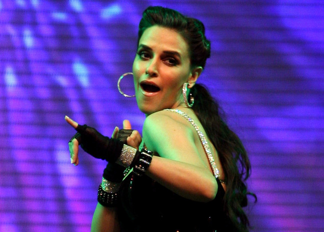 Neha Dhupia gives a live performance during the launch of Lotus Refineries