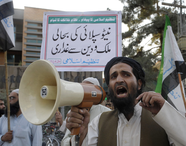 Activists of Tanzeem e Islami Pakistan march at a rally in Quetta against the reopening of supplies to NATO troops in Afghanistan.