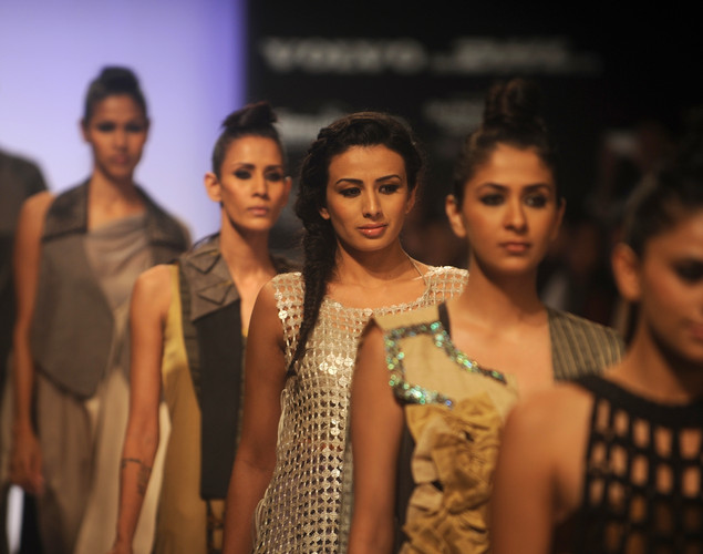 Models showcase creations by Indian designer Roma Narsinghani on the second day of Lakme Fashion Week (LFW) winter/festive 2012 in Mumbai on August 4, 2012.