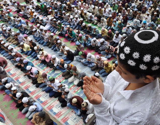 Indian Muslims offer Eid-al-Fitr prayers in the northern hill town of Shimla.