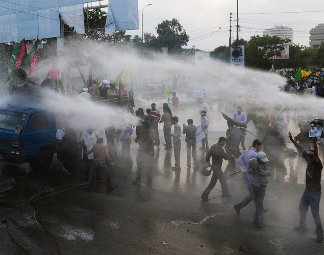 Pakistani policemen use a water cannon to disperse the Shiite Muslim protesters during a rally against an anti-Islam movie in Karachi.