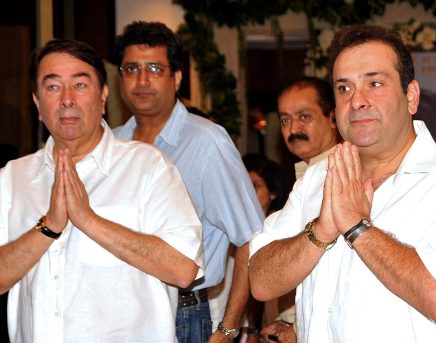 Indian Bollywood actors Randhir Kapoor (L) and Rajiv Kapoor attend a prayer function in memory of late actor Rajesh Khanna in Mumbai.