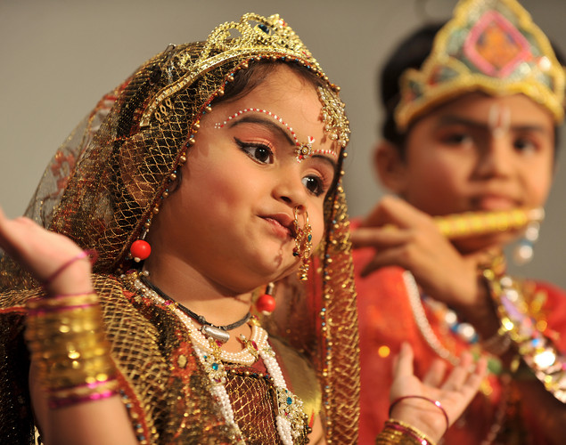 Young Indian Hindu devotees dressed as the Hindu God Lord Krishna (R) and his consort 'Radha' (L) dance during a fancy dress competition held at the International Society for Krishna Consciousness (ISKCON) temple in Bangalore on August 9, 2012 on the eve of 'Krishna Janmashtami'.