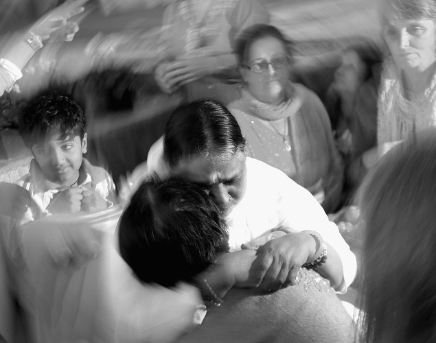 Sri Mata Amritanandamayi Dev, known as 'Amma' (mother) hugs a visitor on the first day of her Melbourne retreat.