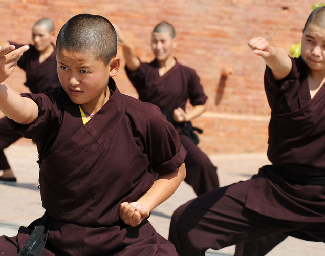 Buddhist nuns practice Kung-fu at the Amitabha Drukpa Nunnery on the outskirts of Kathmandu.