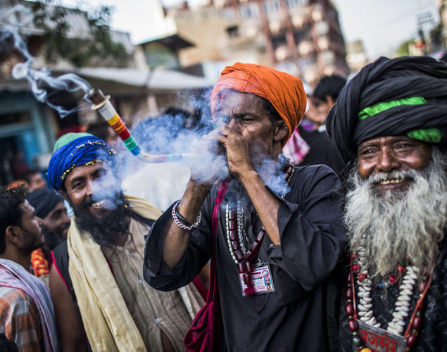 Sufi Muslim devotees smoke marijuana from a pipe during the annual 'Urs' procession.