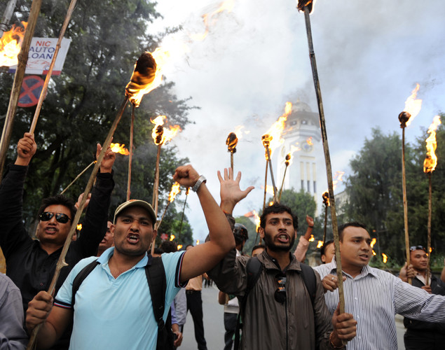 Nepalese Youth Force Wing activists of the Communist Party of Nepal (UML) participate in a torch rally demanding the resignation of Prime Minister Baburam Bhattarai in Kathmandu.