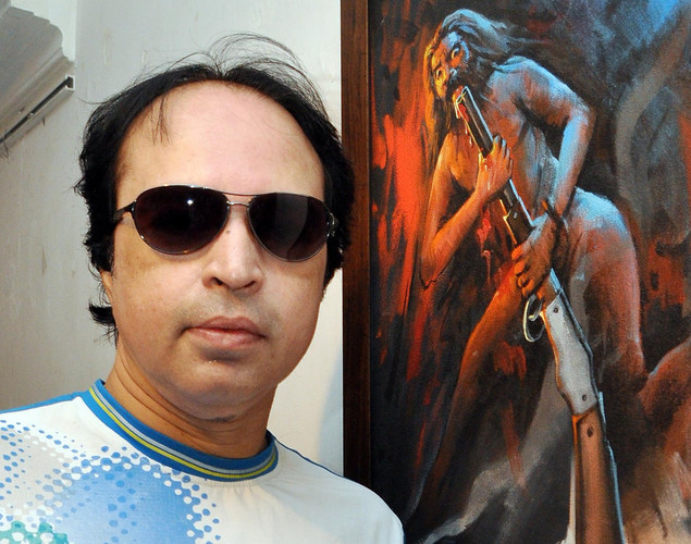 Indian Bollywood playback singer Altaaf Raja poses for a photo during a Painting Exhibition promoting the upcoming film Bandook in Mumbai.