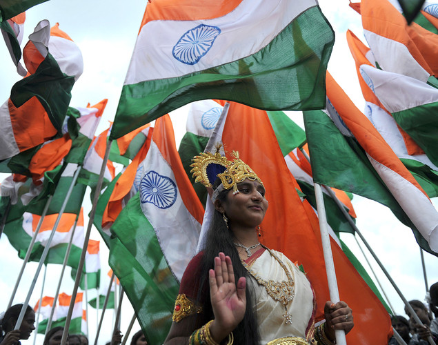 An Indian woman dressed as Bharath Matha (Mother of India) poses with a tricolour flag during India's Independence Day celebrations in Secunderabad, the twin city of Hyderabad, on August 15, 2012.