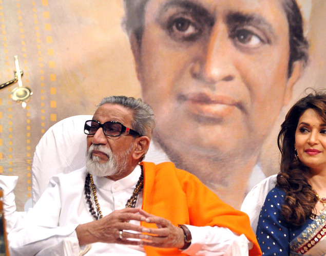 Madhuri Dixit Nene (R) and politician Shiv Sena chief Bal Thackeray attend the 'Deenanath Mangeshkar Puraskar Awards 2012' ceremony in Mumbai.
