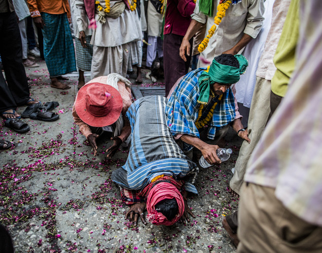 Sufi Muslim devotees kneel to the ground in front of the 'durgah' or shrine, where Muhammad Moin-ud-din Chisti is buried, during the annual 'Urs' procession.