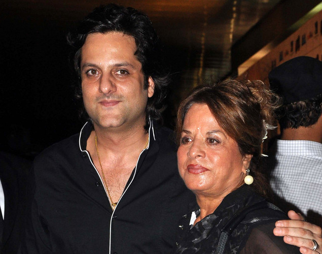 Bollywood film actor Fardeen Khan (L) poses with his mother during the premiere of Hindi film 'Ferrari Ki Sawaari' in Mumbai.